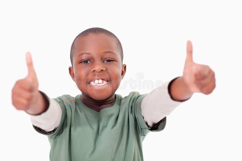 Мальчик с большими пальцами руки вверх стоковые фотографии rf