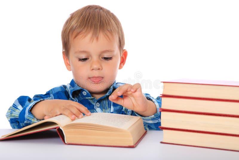 Мальчик с книгами стоковое фото rf