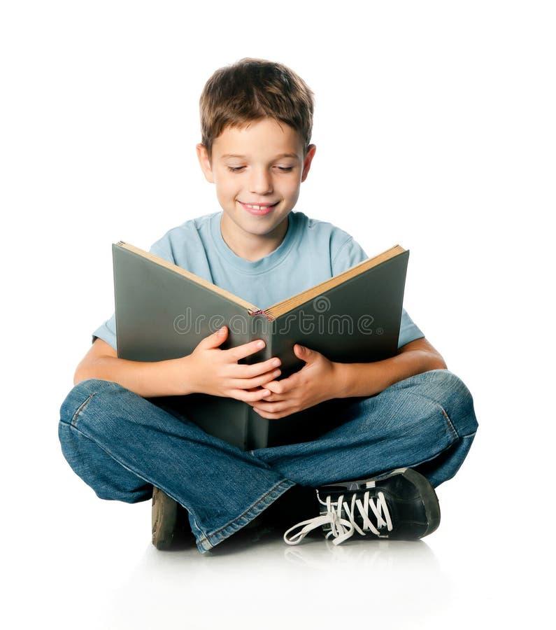 Мальчик с книгой стоковое фото rf