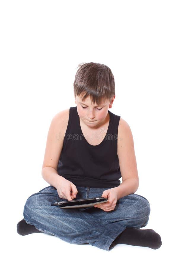 Мальчик с ПК таблетки стоковые изображения