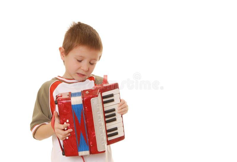 мальчик 35 аккордеонй стоковое фото rf