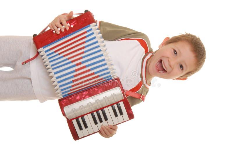 мальчик 5 аккордеонй стоковое фото