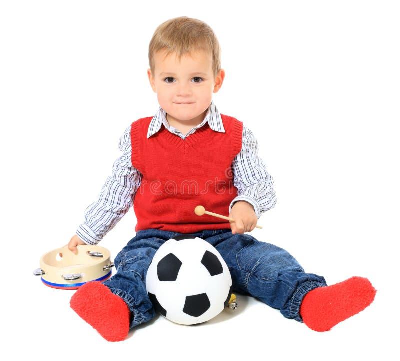Мальчик Cuite европейский играя с игрушками стоковое изображение rf