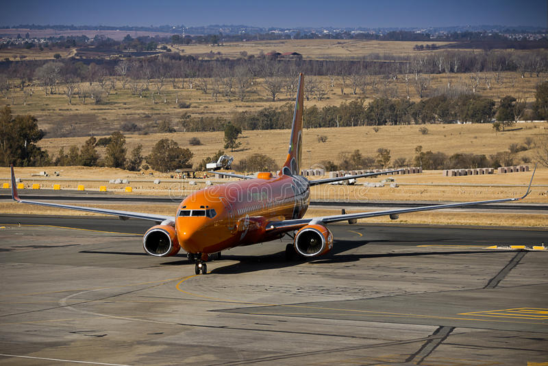 Манго SAA - Боинг 737-8BG - ZS-SJG стоковое фото rf