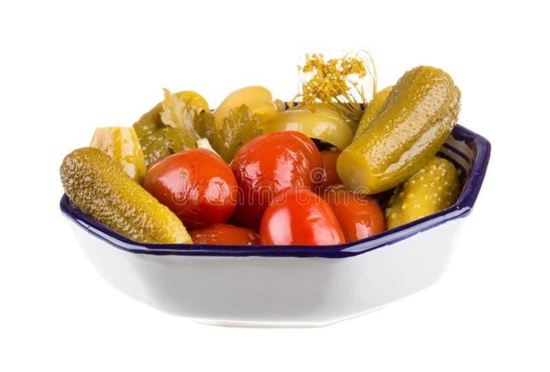 Маринованные овощи - томат и огурец стоковые фото
