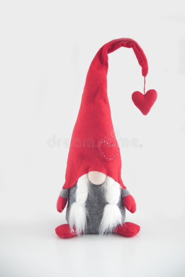 Марионетка Санта Клауса на красном doily, деревянной шерсти стоковое фото rf