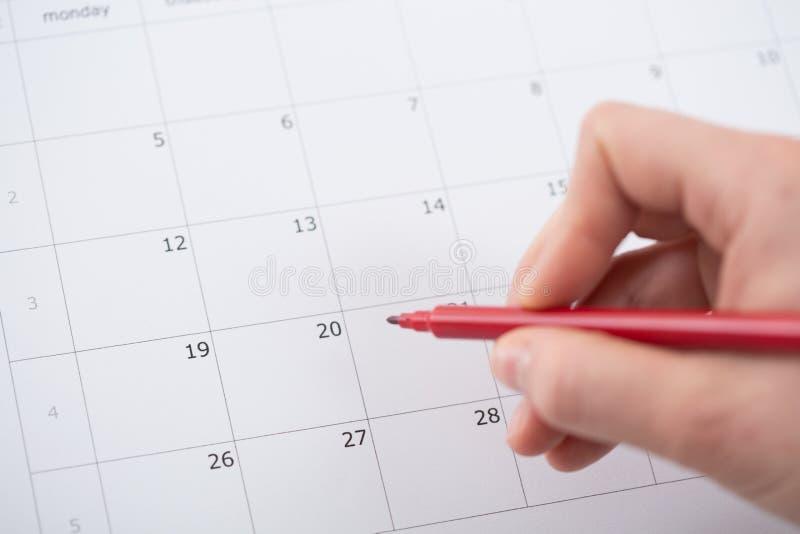 Маркировка в календаре стоковое изображение