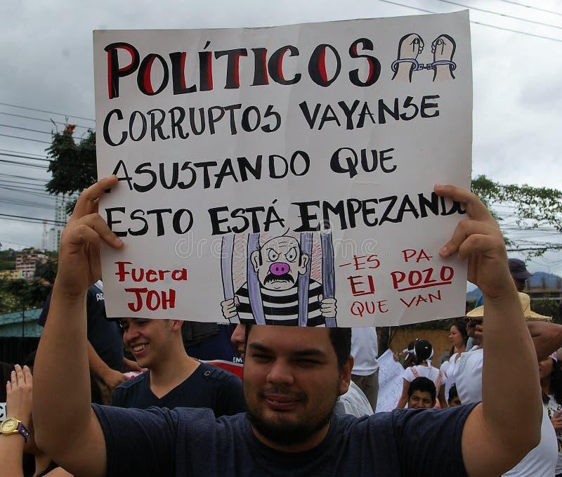 Марш протеста против коррупции и перевыборы Хуана Орландо Hernandez стоковые изображения rf