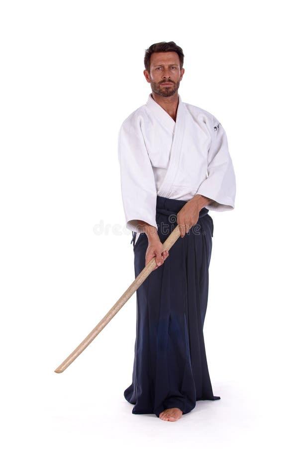 Мастер айкидо с bokken стоковое изображение