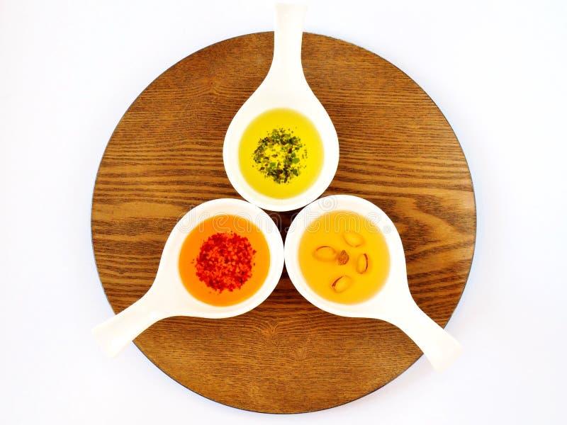 3 масла с специями в шарах стоковое изображение rf