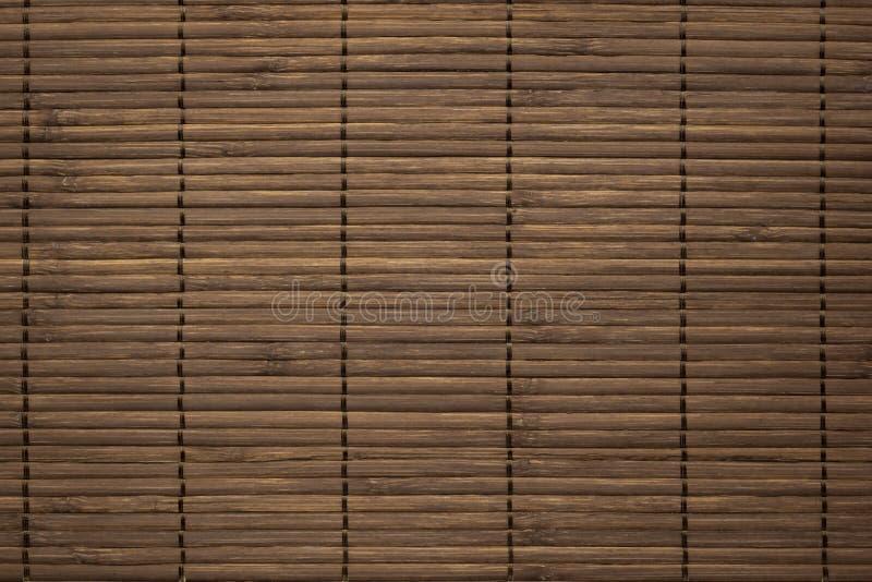 Мата тонко-коричневых бамбуковых палочек текстурированный фон стоковые фото