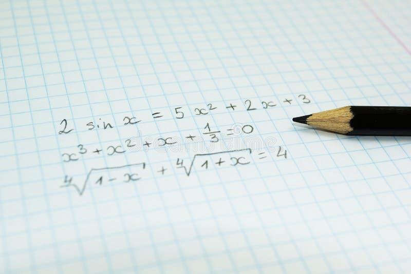 Математические формулы в тетради для лекций стоковая фотография