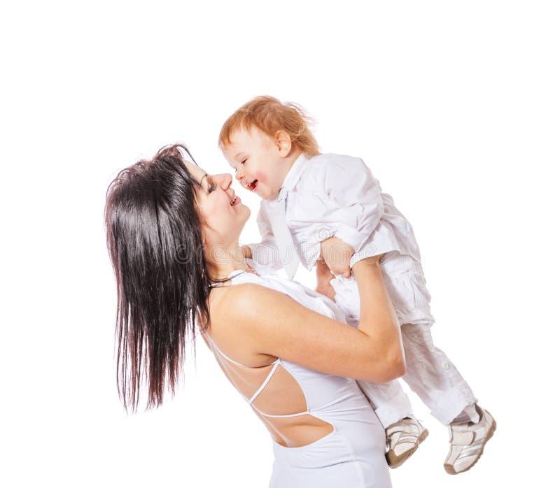 Мать держа сынка стоковые фото