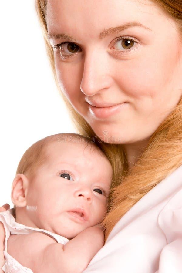 мать удерживания младенца стоковые изображения rf