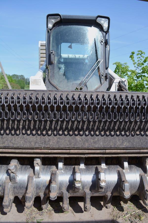 Машинное оборудование Буша и трактора утески дерева стоковые фотографии rf