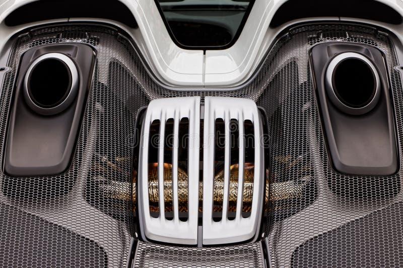 Машинный отсек, сбросы, вытыхание экзотического супер автомобиля спорт Po стоковые изображения rf