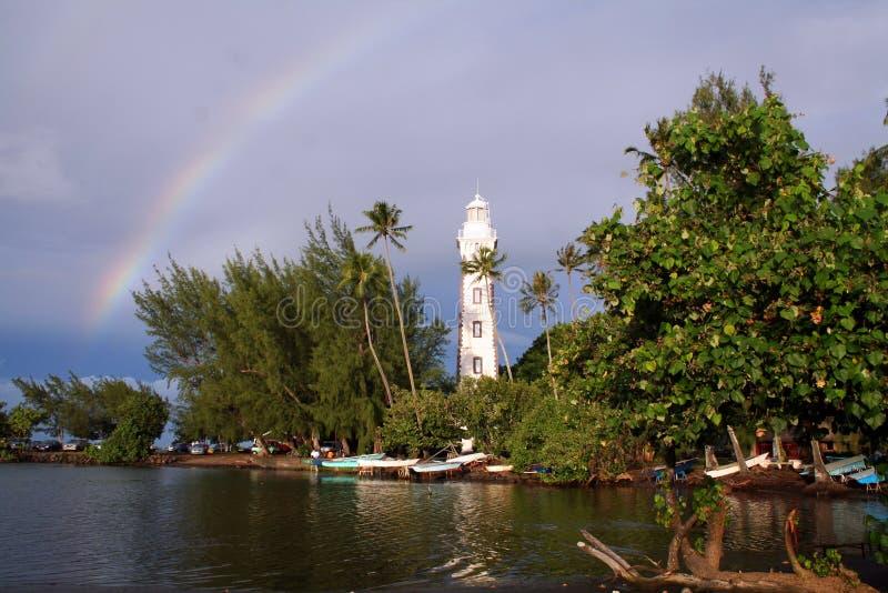 маяк над радугой стоковая фотография