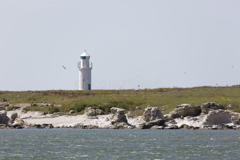 маяк острова утесистый стоковые фото