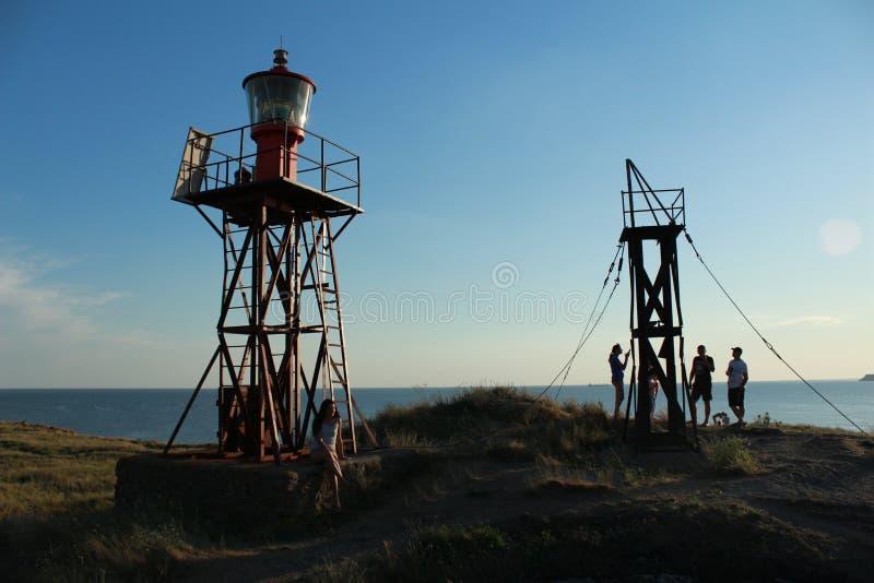 Маяк ‹â€ ‹â€ моря в заходе солнца стоковое фото