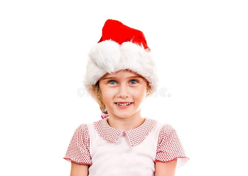 Малая девушка в шляпе Санты стоковое фото