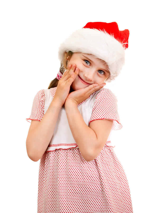 Малая девушка в шляпе Санты стоковые фото