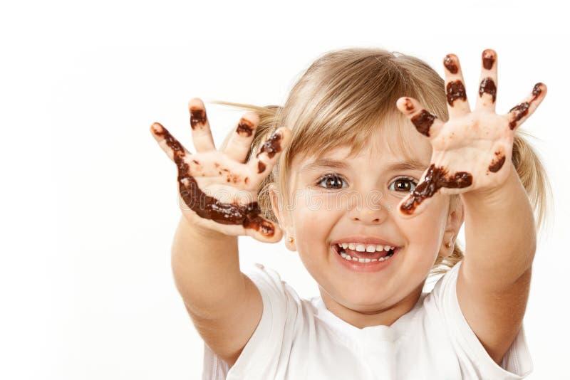 Малая девушка с шоколадом стоковая фотография