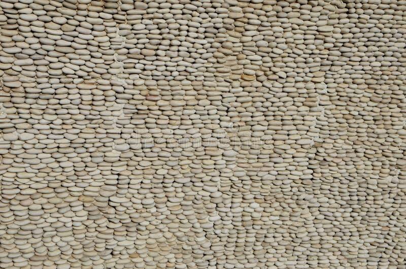 Малая ровная предпосылка текстуры камешков стоковые изображения