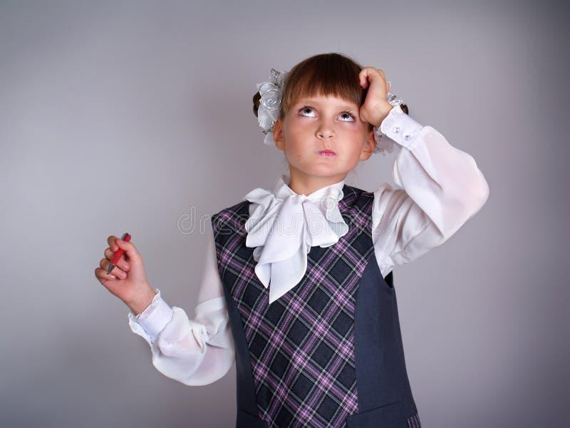 Малая школьница в сером платье стоковые фотографии rf