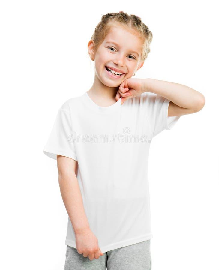 Маленькая девочка в белой футболке стоковая фотография rf