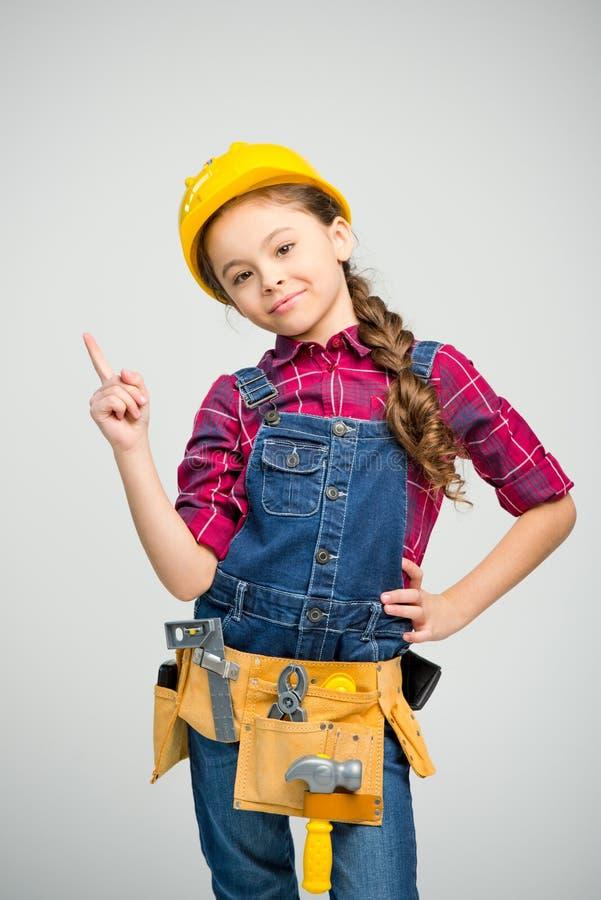 Маленькая девочка в поясе инструмента стоковые изображения rf