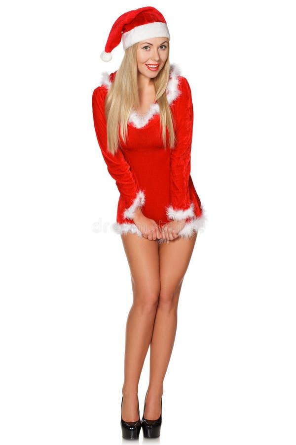 Маленькая девочка в свитере, шляпе, девушке scYoung вкратце одетой как усмехаться Санта Клауса стоковое фото rf
