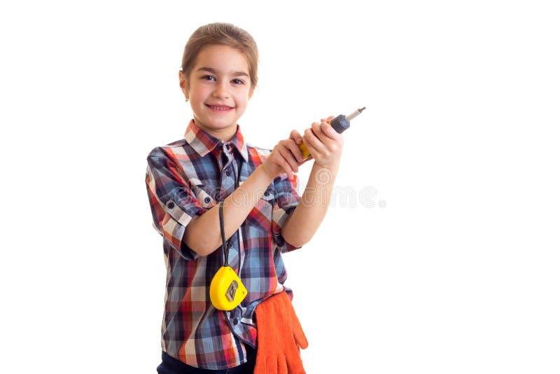 Маленькая девочка держа отвертку и рулетку стоковое фото rf