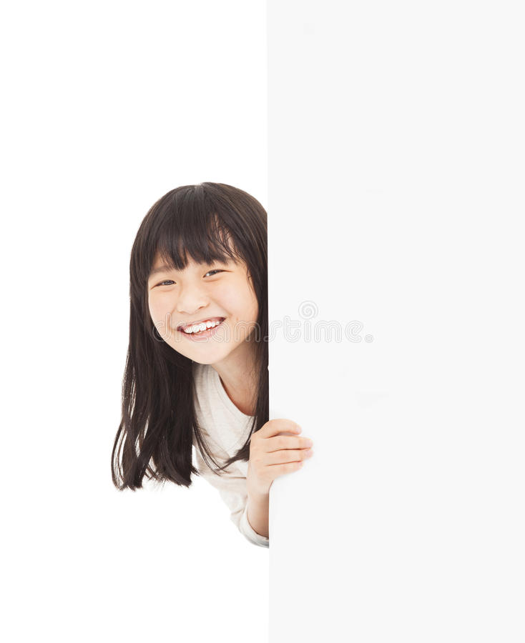 маленькая девочка за белой доской стоковые изображения rf