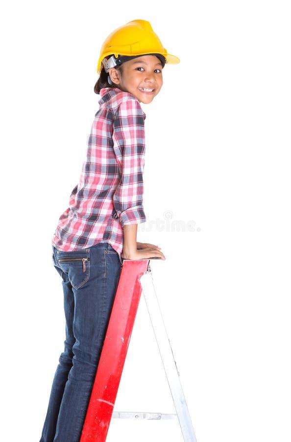 Маленькая девочка на лестнице i стоковая фотография rf