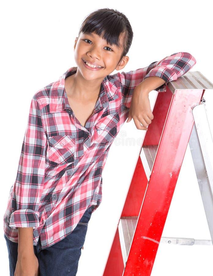 Маленькая девочка на лестнице VIII стоковое изображение rf