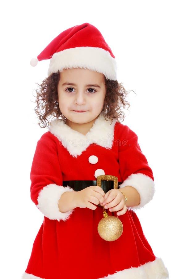 Маленькая девочка одетая как Дед Мороз стоковая фотография rf
