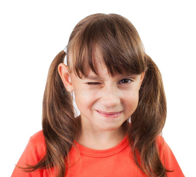 Маленькая девочка подмигивая нам стоковое изображение rf