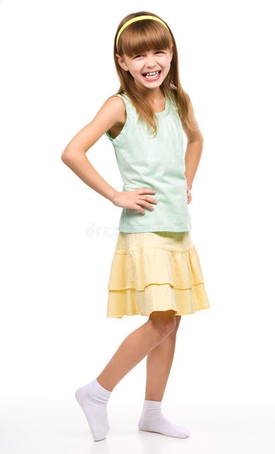 Маленькая девочка стоит стоковое изображение rf