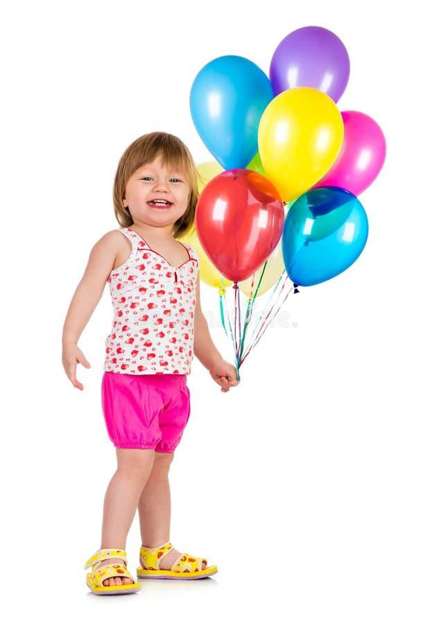 Маленькая девочка ся с воздушными шарами. стоковое изображение rf