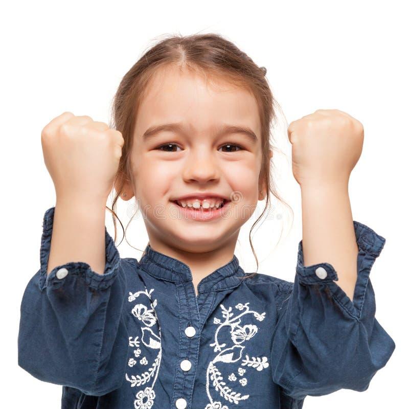 Маленькая девочка с выражением победителя стоковые изображения