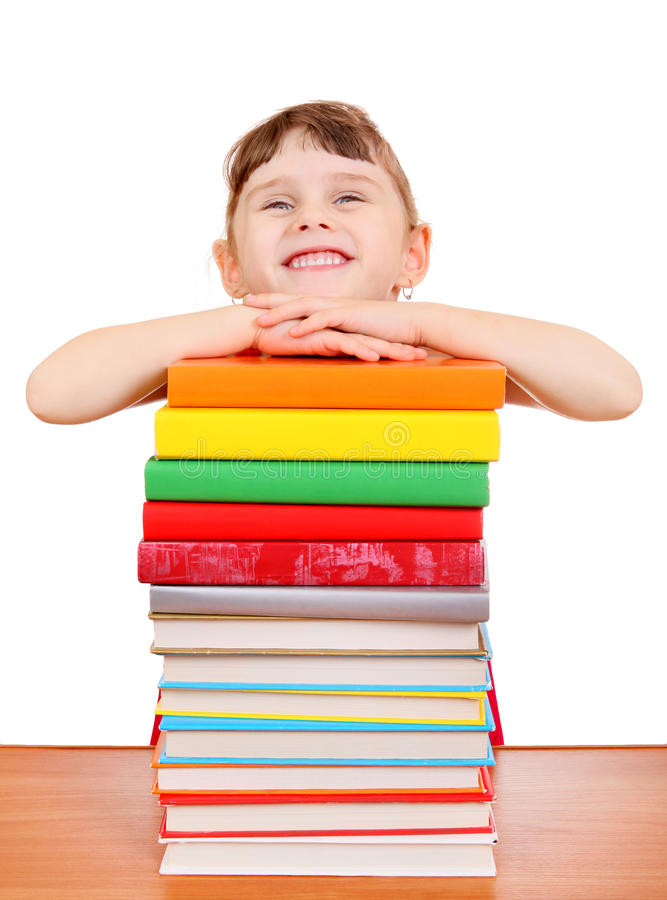 Маленькая девочка с книгами стоковая фотография