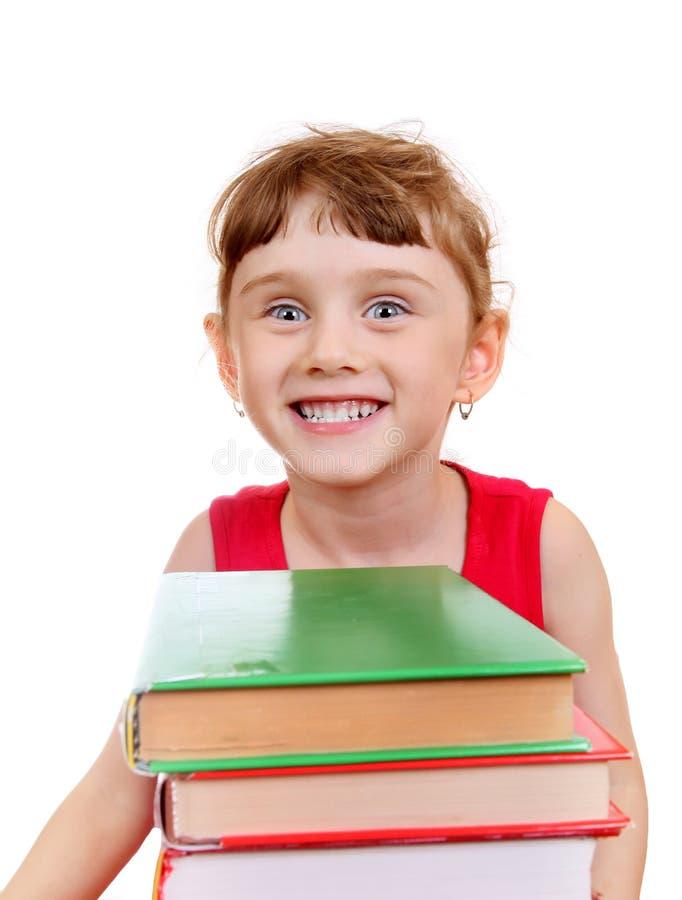 Маленькая девочка с книгами стоковые изображения rf