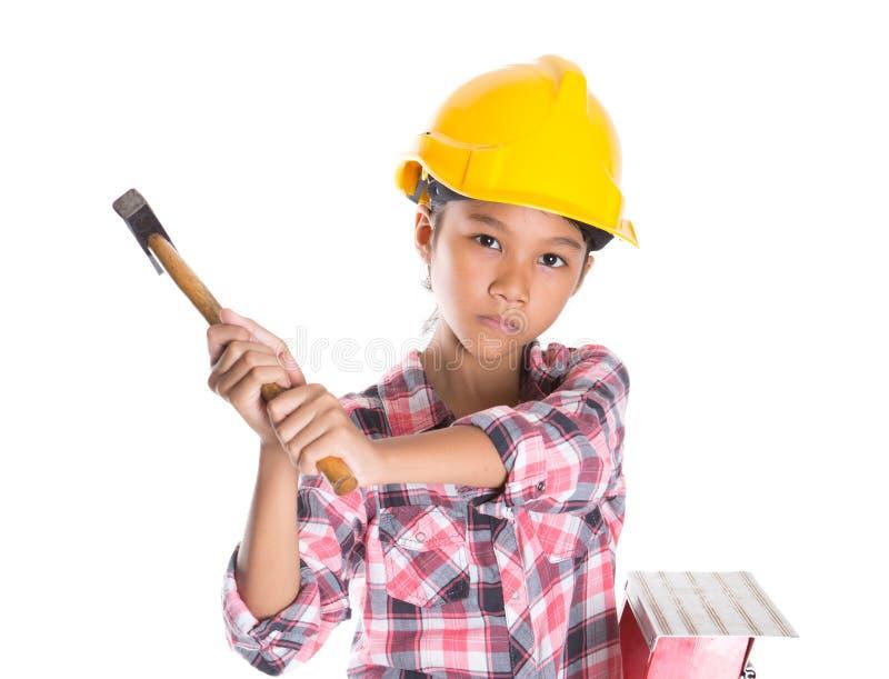 Маленькая девочка с молотком стоковая фотография rf