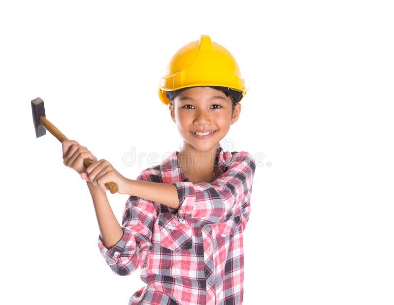 Маленькая девочка с молотком VI стоковая фотография