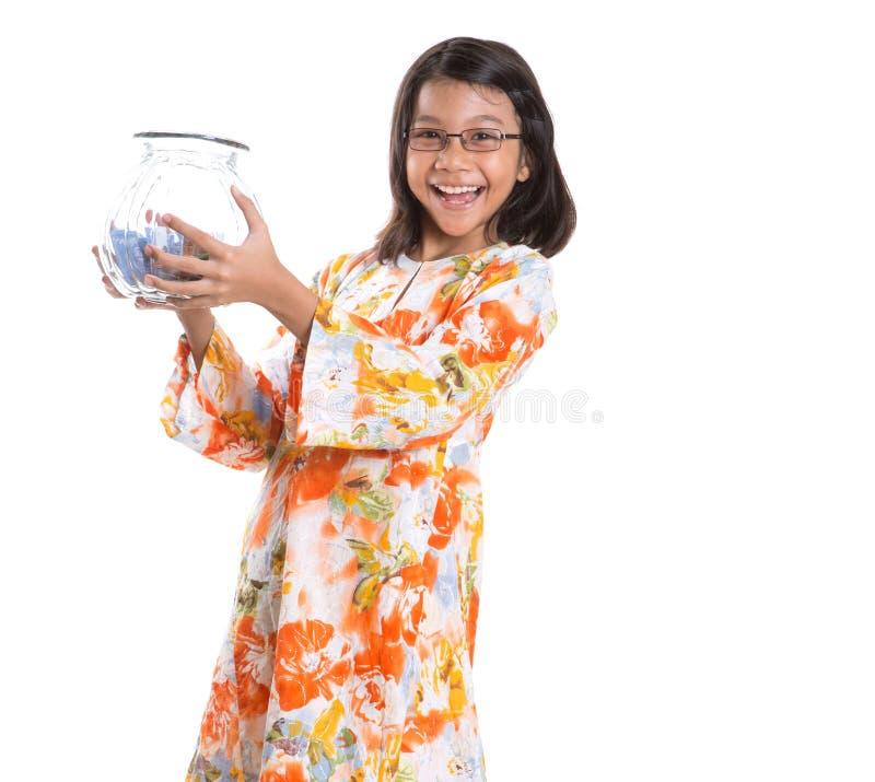 Маленькая девочка с опарником II денег стоковые изображения