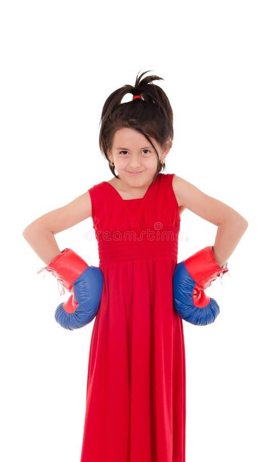 Маленькая девочка с перчатками бокса стоковые изображения