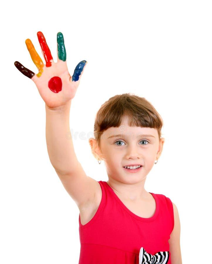 Маленькая девочка с покрашенной ладонью стоковое фото