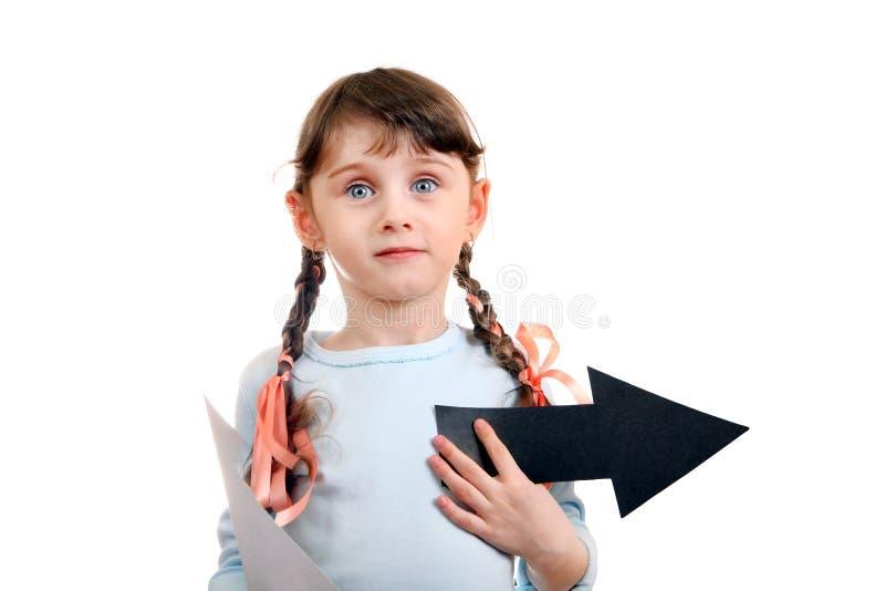 Маленькая девочка с стрелкой стоковое фото