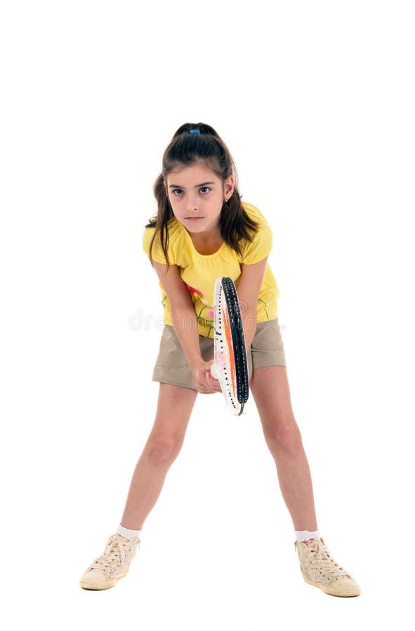 Маленькая девочка с теннисом игр стоковые изображения
