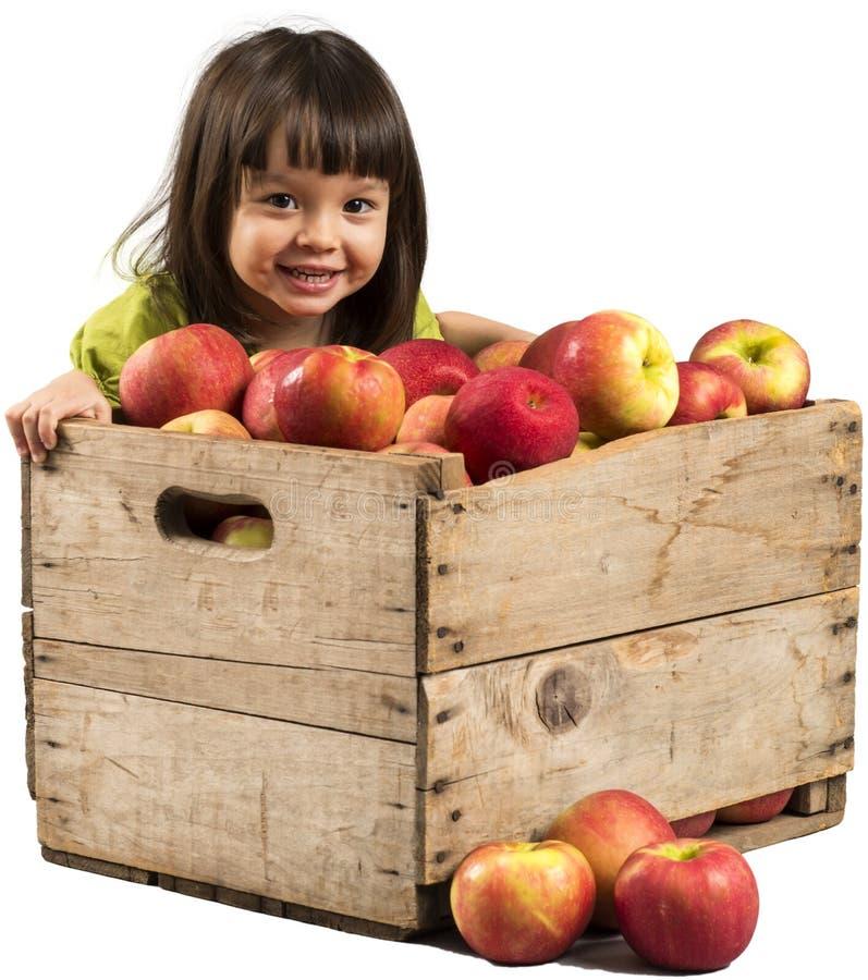 Маленькая девочка с яблоками стоковое изображение